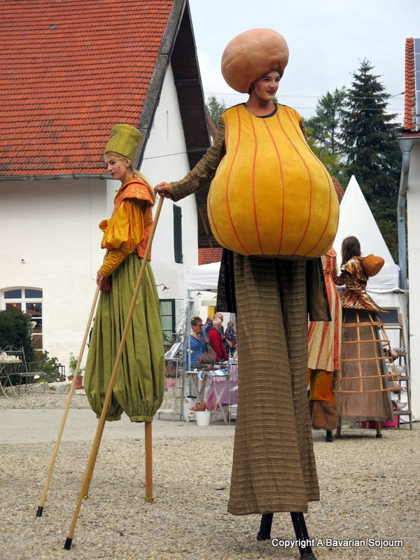 pumpkin stilt walkers