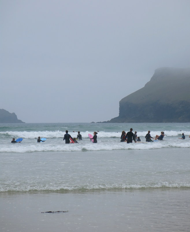 surfing in the mist on Polzeath Beach