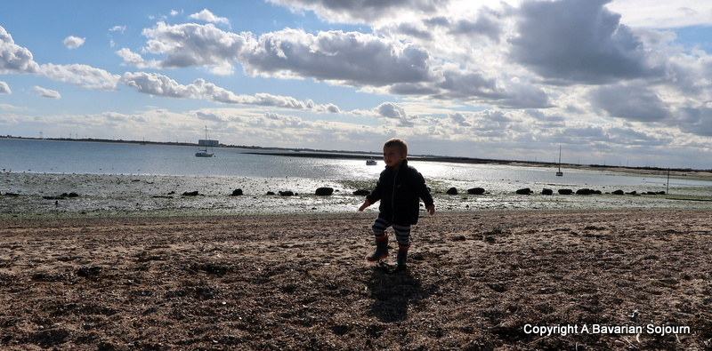 child chasing shadow mersea beach
