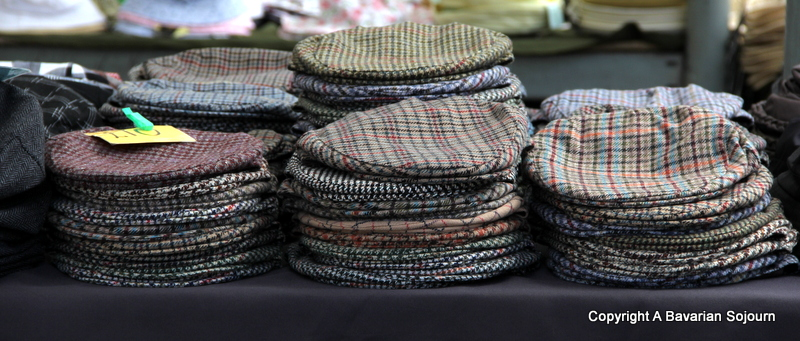 flat caps on a market stall