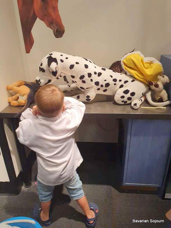 small boy pretending to be a vet at the Glazier Museum